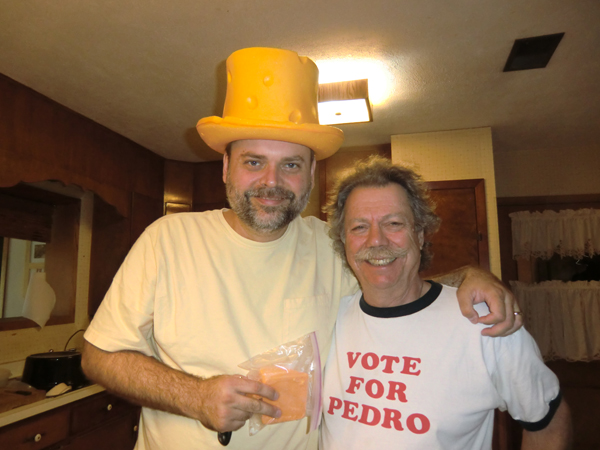 Stephen Seifert & Tom Garrett with 12 year old cheddar cheese and cheese hat